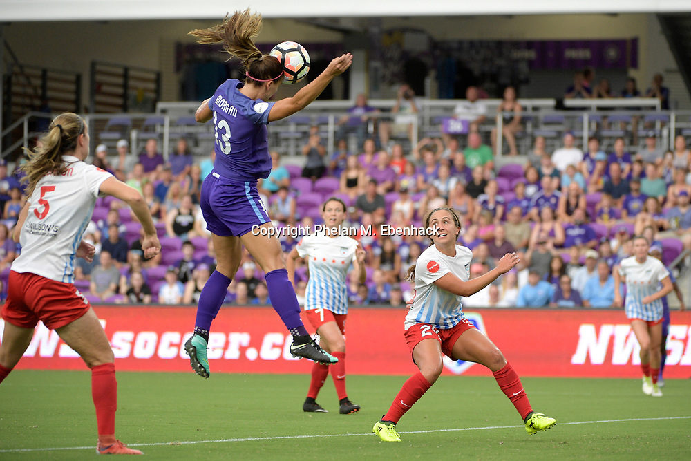 Orlando Pride's Alex Morgan (13) attempts a shot on goal between Chicago Red Stars Katie Naughton (5) and Danielle Colaprico (24) during the first half of an NWSL soccer match on Saturday, Aug. 5, 2017, in Orlando, Fla. (Photo by Phelan M. Ebenhack)