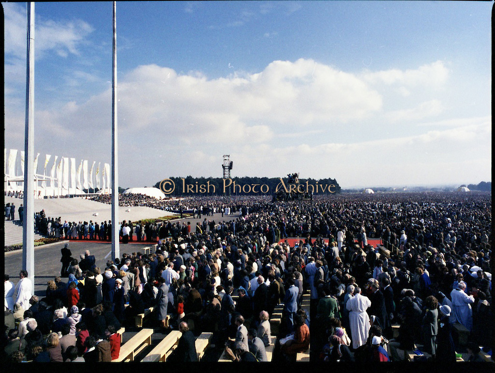 Pope John-Paul II visits Ireland..1979..29.09.1979..09.29.1979..29th September 1979..Today marked the historic arrival of Pope John-Paul II to Ireland. He is here on a three day visit to the country with a packed itinerary. He will celebrate mass today at a specially built altar in the Phoenix Park in Dublin. From Dublin he will travel to Drogheda by cavalcade. On the 30th he will host a youth rally in Galway and on the 1st Oct he will host a mass in Limerick prior to his departure from Shannon Airport to the U.S..A view of the congregation in the Phoenix Park as they receive Holy Communion from members of the clergy.