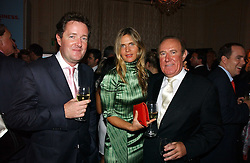 Left to right, PIERS MORGAN, CELIA WALDEN and ANDREW NEIL at a party to celebrate the launch of The Business - London's First Global Business Magazine held at the Mandarin Oriental Hyde Park, 66 Knightsbridge, London on 11th October 2006.<br /><br />NON EXCLUSIVE - WORLD RIGHTS