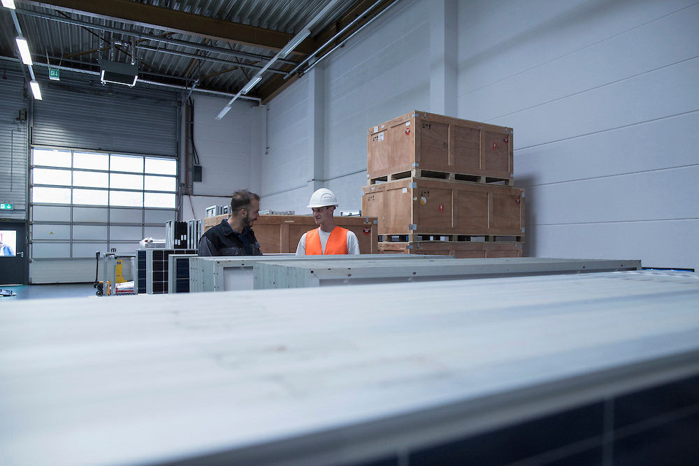 Store workers working in a distribution warehouse, Freiburg im Breisgau, Baden-Wuerttemberg, Germany