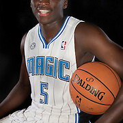 Victor Oladipo poses in front of a backdrop during the Orlando Magic media day event at the Amway Arena on Monday, September 30, 2103 in Orlando, Florida. (AP Photo/Alex Menendez)