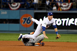 October 31, 2017 - Los Angeles, CA, USA - Los Angeles Dodgers second baseman Chase Utley (26) forces out Houston Astros' Josh Reddick (22) at second base as Evan Gattis (not pictured) is safe on first base on a fielders choice in the 7th inning of game six of a World Series baseball game at Dodger Stadium on Tuesday, Oct. 31, 2017 in Los Angeles. (Credit Image: © Keith Birmingham/Los Angeles Daily News via ZUMA Wire)