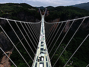 ZHANGJIAJIE, May 17, 2016 <br /> <br /> - An aerial photo taken on May 17, 2016 shows the nearly finished construction site of a glass bridge at the Grand Canyon of Zhangjiajie National Forest Park, central China's Hunan Province. The 430-meter-long, 6-meter-wide bridge is expected to be put into a trial operation in May. The structure has undergone nearly 100 safety tests to ensure that it can support the weight of 800 people. (Xinhua/Long Hongtao) (wyl) <br /> ©Exclusivepix Media