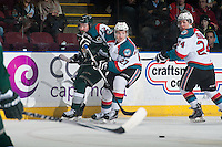 KELOWNA, CANADA - JANUARY 23: Josh Morrissey #27 of Kelowna Rockets checks Patrick Bajkov #8 of Everett Silvertips into the boards as he passes the puck during first period on January 23, 2015 at Prospera Place in Kelowna, British Columbia, Canada.  (Photo by Marissa Baecker/Shoot the Breeze)  *** Local Caption *** Josh Morrissey; Patrick Bajkov;