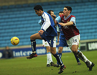 MILLWALL VS BURNLEY<br /> 28TH  FEBRUARY 2004<br /> TIM CAHILL GETS AWAY FROM BRADLEY ORR<br /> Sportsbeat Images