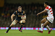 Sam Warburton of Wales (l)  in action.Under Armour 2016 series international rugby, Wales v Japan at the Principality Stadium in Cardiff , South Wales on Saturday 19th November 2016. pic by Andrew Orchard, Andrew Orchard sports photography