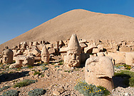 Statue head of from left, Antiochus, Zeus, Commagene, Apollo, Herekles & Eagle in front of the 62 BC Royal Tomb of King Antiochus I Theos of Commagene, west Terrace, Mount Nemrut or Nemrud Dagi summit, near Adıyaman, Turkey .<br /> <br /> If you prefer to buy from our ALAMY PHOTO LIBRARY  Collection visit : https://www.alamy.com/portfolio/paul-williams-funkystock/nemrutdagiancientstatues-turkey.html<br /> <br /> Visit our CLASSICAL WORLD HISTORIC SITES PHOTO COLLECTIONS for more photos to download or buy as wall art prints https://funkystock.photoshelter.com/gallery-collection/Classical-Era-Historic-Sites-Archaeological-Sites-Pictures-Images/C0000g4bSGiDL9rw