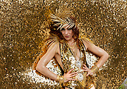 """Portrait of Dutch performance artist, Merante Tamar van Amersfoort, who performs under the name, """"Merante in Wonderland"""" wearing a gold costume called the Sun Goddess for Diversity at Tokyo Rainbow Pride festival, Yoyogi Park, Tokyo, Japan. Sunday April 27th 2014 This was the third year this annual gay-pride event has been held in Japan capital.with food, fashion and health care stalls and musical performances set up in Yoyogi Park event square and a colourful parade around Shibuya at 1pm."""
