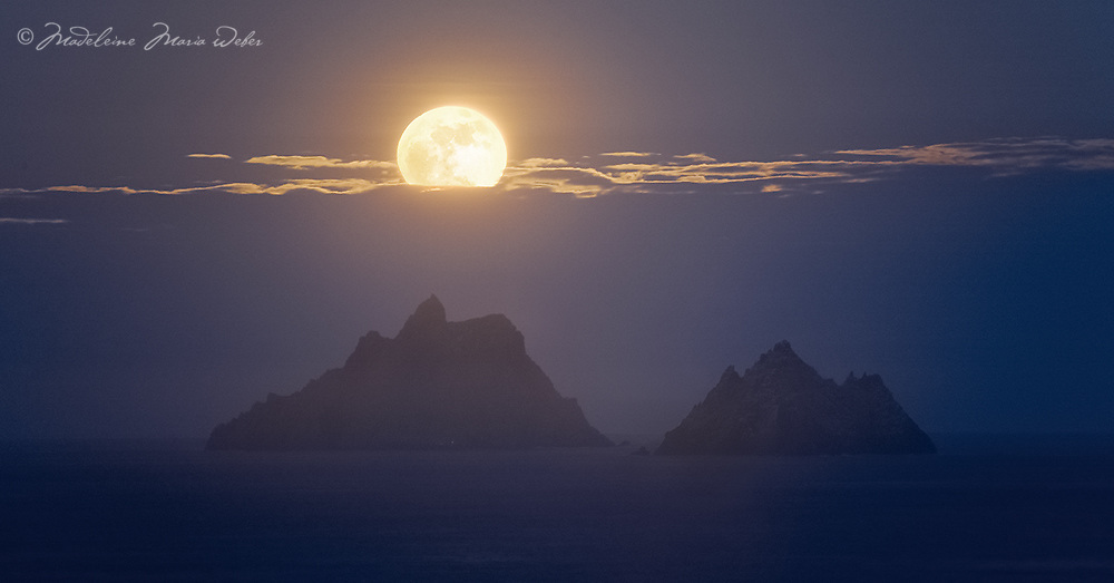 Full Moon setting behind Skellig Michael and Little Skellig, County Kerry, Ireland ****** <br /> <br /> Visit & browse through my Photography & Art Gallery, located on the Wild Atlantic Way & Skellig Ring between Waterville and Ballinskelligs (Skellig Coast R567), only 3 minutes from the main Ring of Kerry road.<br /> https://goo.gl/maps/syg6bd3KQtw<br /> <br /> ******<br /> <br /> Contact: 085 7803273 from an Irish mobile phone or +353 85 7803273 from an international mobile phone