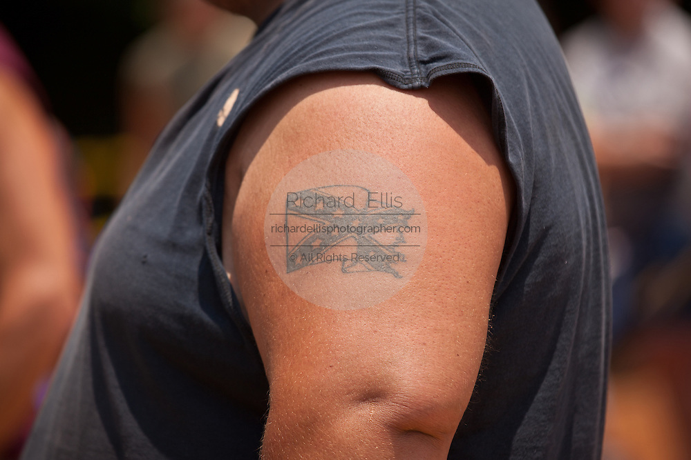 A confederate flag tattoo on a participant during the annual Summer Redneck Games Dublin, GA.
