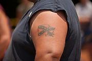 A confederate flag tattoo on a participant during the annual Summer Redneck Games Dublin, GA.