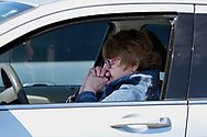 Sherry Orender, of Treichlers, participates in Bethany Wesleyan Church's Sunday worship service Mar. 22, 2020, at Becky's Drive-In in Walnutport, Pennsylvania. Concerns over the coronavirus have closed churches in an effort to avoid gatherings of large crowds.