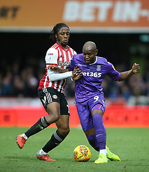 Brentford's Romaine Sawyers (left) and Stoke City's Benik Afobe battle for the ball