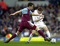 Photo: Greig Cowie<br />Barclaycard Premiership. Leeds United v West Ham United. 08/02/2002<br />Ian Pearce trys to get a tackle in on James Milner
