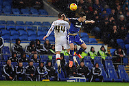 Cardiff City's Tom Lawrence (r) challenges M K Dons Jake Forster-Caskey in the air. Skybet football league championship match, Cardiff city v MK Dons at the Cardiff city stadium in Cardiff, South Wales on Saturday 6th February 2016.<br /> pic by Carl Robertson, Andrew Orchard sports photography.