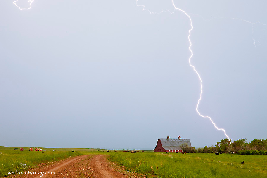 Lightning hits close to red barn near Ekalaka Montana