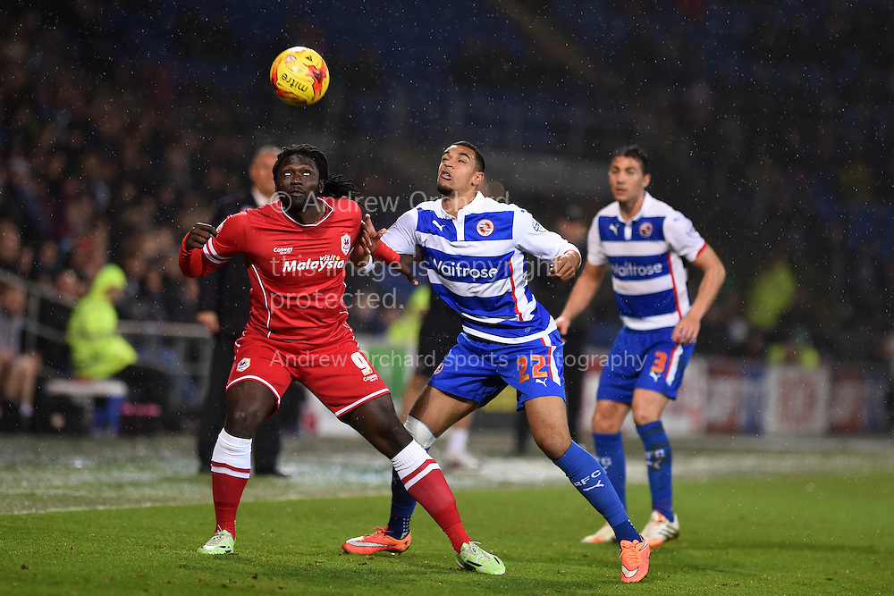 Cardiff's Kenwyne Jones (l) and Reading's Nick Blackman keep a close eye on the ball. Skybet football league championship match, Cardiff city v Reading at the Cardiff city stadium in Cardiff, South Wales on Friday 21st November 2014<br /> pic by Andrew Orchard, Andrew Orchard sports photography.