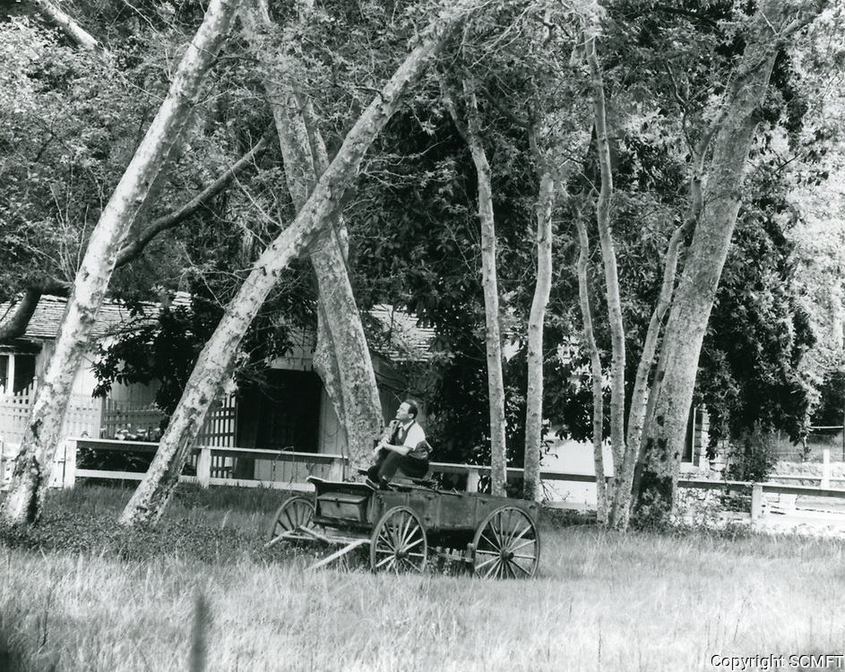 Early 1960s Huntington Hartford sitting in a buckboard on his Runyon Canyon property