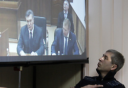 November 25, 2016 - Kiev, Ukraine - Former Ukrainian president Viktor Yanukovych (L) is seen on a screen by via live video link from Russia,as he attends a hearing during a trial session in a district court in Kiev, Ukraine, 25 November 2016. Svyatoshinsky District Court of Kyiv held a hearing in the case of the Maidan events, questioning witness Ukrainian former Viktor Yanukovych(C) in the case of five former Berkut riot police officers, who are accused of murdering Maidan activists in February 2014. (Credit Image: © Serg Glovny via ZUMA Wire)