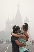 Moscow, Russia, 07/08/2010. .A young couple wearing gas masks kiss in Red Square in the worst smog so far in the record high temperatures of the continuing heatwave. Peat and forest fires in the countryside surrounding Moscow have resulted in the Russian capital being blanketed in heavy smog.