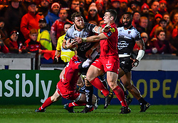 Toulon's Duane Vermeulen is tackled by Scarlets' Scott Williams<br /> <br /> Photographer Craig Thomas/Replay Images<br /> <br /> European Rugby Champions Cup Round 5 - Scarlets v Toulon - Saturday 20th January 2018 - Parc Y Scarlets - Llanelli<br /> <br /> World Copyright © Replay Images . All rights reserved. info@replayimages.co.uk - http://replayimages.co.uk