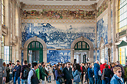 Painted ceramic tileworks (Azulejos) on the interior walls of Main hall of Sao Bento Railway Station in Porto, Portugal