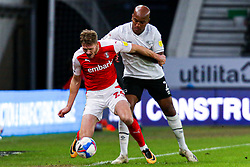 Michael Smith of Rotherham United is pushed by Andre Wisdom of Derby County - Mandatory by-line: Ryan Crockett/JMP - 16/01/2021 - FOOTBALL - Pride Park Stadium - Derby, England - Derby County v Rotherham United - Sky Bet Championship