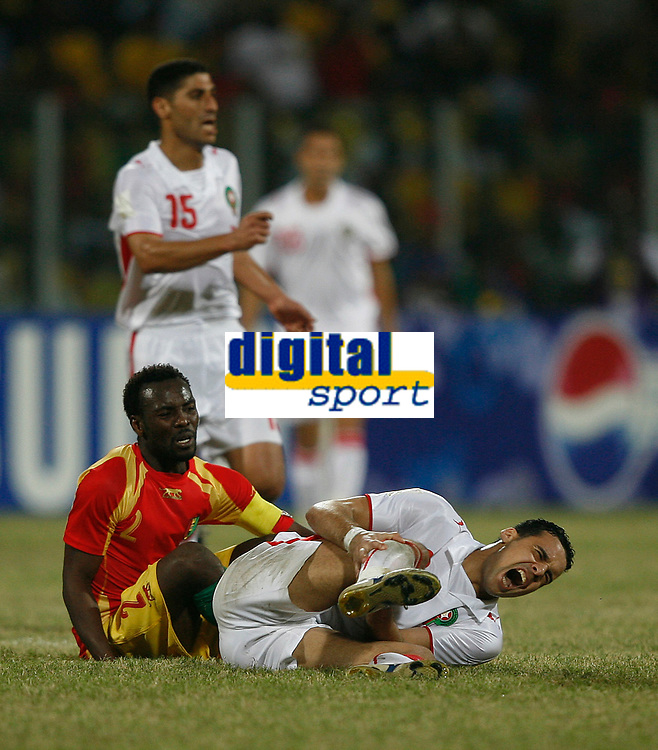 Photo: Steve Bond/Richard Lane Photography.<br /> Guinea v Morocco. Africa Cup of Nations. 24/01/2008. Pascale Feindounou (L) goes to ground after kicking Elamin Erbate (R)