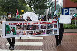 Stop The Arms Fair activists hold a banner referencing human rights abuses in Nigeria during a protest outside ExCeL London on the first day of the DSEI 2021 arms fair on 14th September 2021 in London, United Kingdom. Activists from a range of different groups have been protesting outside the venue for one of the world's largest arms fairs for over a week.