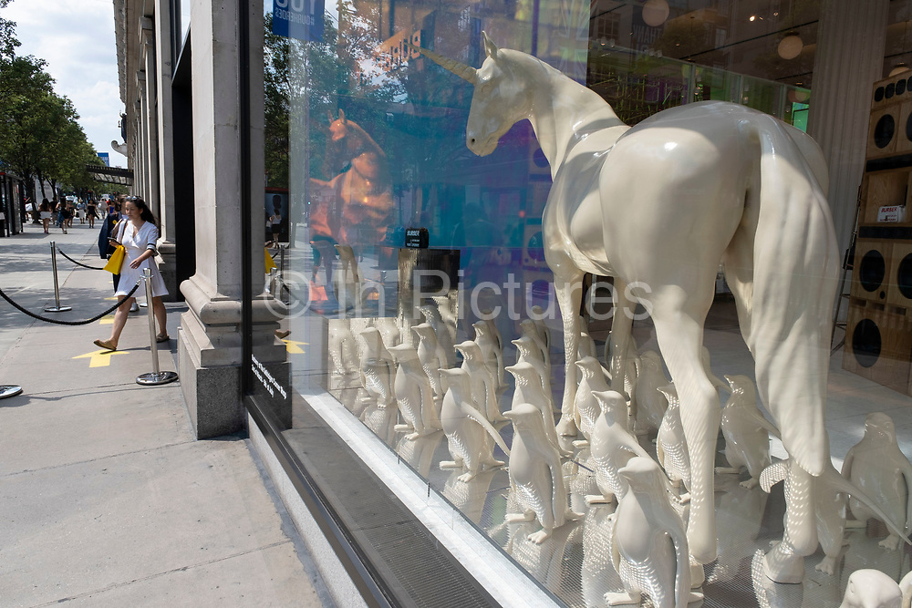 A unicorn window display in Burberry as some non-essential shops re-open, shoppers return to Oxford Street while social distancing measures are put in place by the various retail shops which are open on 26th June 2020 in London, England, United Kingdom. As the July deadline approaces and government will relax its lockdown rules further, the West End remains quiet, apart from this popular shopping district, which itself has far fewer people on its pavements than normal.