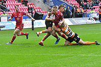Rugby Union - 2019 / 2020 Guinness Pro14 - Scarlets vs. Cheetahs<br /> <br /> Johnny McNicholl of Llanelli Scarlets  tackled by Tian Schoeman of Cheetahs, at Parc y Scarlets.<br /> <br /> COLORSPORT/WINSTON BYNORTH