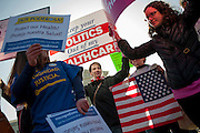 Protesters from both sides campaigned outside of the U.S. Supreme Court on Tuesday as the court began listened to oral arguments over the constitutionality of the individual mandate portion of the health care law championed by President Barack Obama.