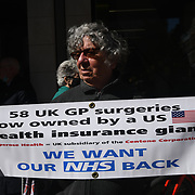 Protestors, protest against US Centene Corporation has bought up 49 London GP practices of fear its will ruin UK NHS in London, on 22nd April 2021.