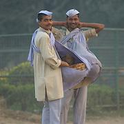 Two young hawkers selling Chana Jhor Garam near Victoria memorial in Kolkata, India. The uniform is unique to the hawkers selling Chana Jhor Garam in Kolkata.