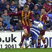 © Peter Spurrier/Sportsbeat Images <br /><br /> <br />04/10/2003 - Photo  Peter Spurrier<br />2003/04 Nationwide Football Div 1 Reading Town FC v Bradford City FC.<br />Bradford's Simon Francis [left] turns John Salako.