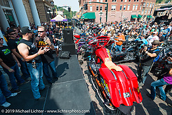 Chris McGee with the winner of the Legends Ride annual auction bike in Deadwood, SD during the Sturgis Black Hills Motorcycle Rally. SD, USA. August 4, 2014.  Photography ©2014 Michael Lichter.