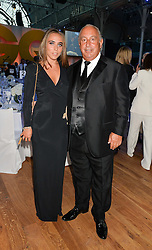 SIR PHILIP GREEN and his daughter CHLOE GREEN at the GQ Men Of The Year 2014 Awards in association with Hugo Boss held at The Royal Opera House, London on 2nd September 2014.