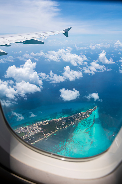 View from an airplane window shortly after departure from Cancun. The island is Isla Mujeres.