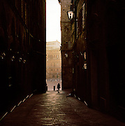 Piazza Del Campo, seen through a side street, Siena, Italy