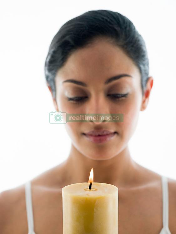 Jul. 26, 2012 - Woman with candle (Credit Image: © Image Source/ZUMAPRESS.com)