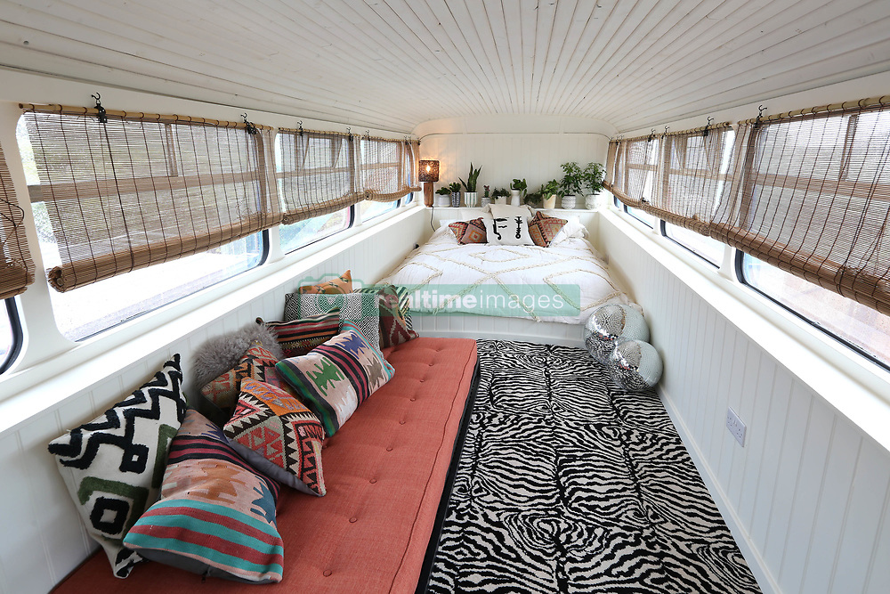 """Fancy spicing up your night? Now you can with a stay in the iconic bus from the Spice Girls movie. Host Suzanne Godley teamed up with Airbnb to create this unique and nostalgic stay in time for the Spice Girls reunion tour. The accommodation is made from the original Union Jack bus from the Spice Girls' 1997 movie Spice World, which was then converted into a luxury apartment. The Spice Bus will be situated in the heart of Wembley Park, London, where guests will be able to stay overnight from June 14. The recently renovated living area features pink Union Jack cinema chairs below a 'Girl Power' neon light installation and is fully stocked with vintage 90s magazines and CDs to help recreate the 90s era. With bold interiors, potted plants create a fresh homely feel downstairs while bright colourful scatter cushions surround the central seating area, providing a comfy place for guests to relax and spend time with each other. Upstairs there's a dressing and the adjoining bedroom, which is fitted with a striking animal-print carpet, provides comfy bedding for three guests who get to call the Spice Bus home for the night. Suzanne, who is a Spice Girls superfan, said: """"When my boss mentioned that he was considering buying the Spice Bus I was desperate to be a part of its renovation. We've worked hard over the past few months to turn the bus into a home, in keeping with its legacy, and I'm so excited to open it up to the public with the support of Airbnb. Being part of this project has been like a dream come true and I can't wait to meet other Spice Girls fans through this experience."""". 15 May 2019 Pictured: Spice bus converted to Airbnb. Photo credit: Airbnb / MEGA TheMegaAgency.com +1 888 505 6342"""