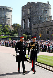 Prince Harry (left) and the Duke of Cambridge arrive at St George's Chapel at Windsor Castle for the wedding of Meghan Markle and Prince Harry.