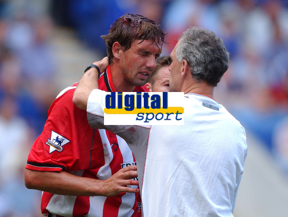 Southampton's Claus Lundekvam has to leave the field after sustaining a head injury when he clashed with Les Ferdinand as the 2nd Leicester goal was scored. Leicester City v Southamptonr, FA Premiership, 16/08/2003. Credit:  DIGITALSPORT  / Matthew Impey DIGITAL FILE ONLY