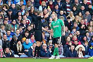 Bradley Wood of Lincoln City receives a yellow card from referee Graham Scott. The Emirates FA cup 5th round match, Burnley v Lincoln City at Turf Moor in Burnley, Lancs on Saturday 18th February 2017.<br /> pic by Chris Stading, Andrew Orchard Sports Photography.