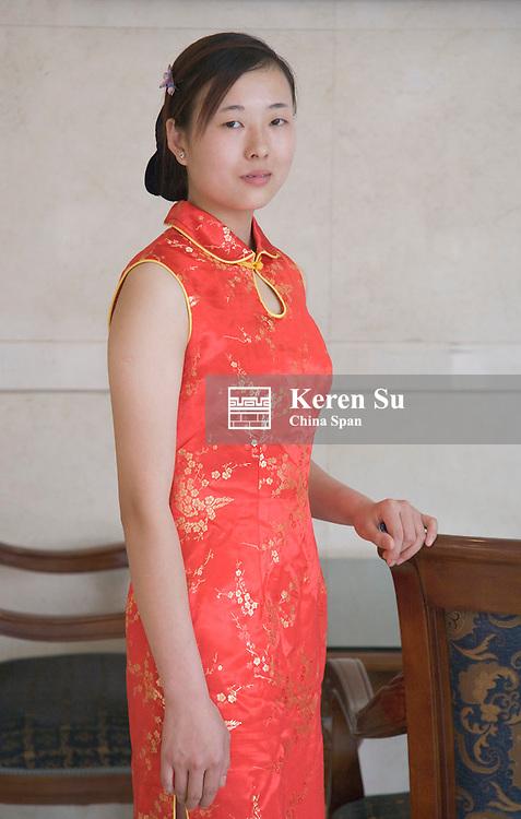 Girl in traditional dress, Qipao, China