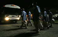 """Roger Dale """"Pop"""" Smith, 60, right, walks with fellow  inmates to the bus that will take them to the Grey Hound bus station. All five men were released from prison and given a bus ticket to their choice destination in the state."""