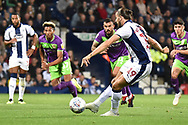 West Bromwich Albion striker Jay Rodriguez (19) scores a goal from the penalty spot  1-0 during the EFL Sky Bet Championship match between West Bromwich Albion and Bristol City at The Hawthorns, West Bromwich, England on 18 September 2018.