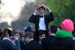 © London News Pictures. 01/05/2016. Oxford, UK. An Oxford university student puts on a make as people gather to celebrate May Day in the early hours of the morning near Magdalen Bridge in Oxford, Oxfordshire. This year people were again prevented from jumping from the bridge in to the water due to serious injuries sustained at a previous years event . Photo credit: Ben Cawthra/LNP