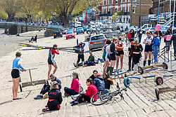 Licensed to London News Pictures. 01/05/2021. London, UK. Rowers and members of the public take advantage of the Bank Holiday weekend along the Thames at Putney South West London today. This month Covid-19 restrictions were lifted with more freedoms to meet friends and have picnics in the parks as pubs and staycations open up for the long May Bank Holiday weekend with temperatures expected to be 14c in the South East with a possibility of rain forecast. Photo credit: Alex Lentati/LNP