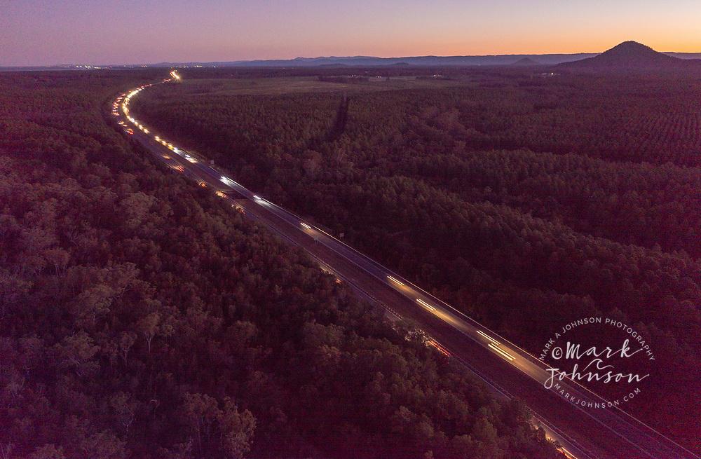Aerial view of traffic on M1 Motorway, aka the Bruce Highway, Queensland, Australia